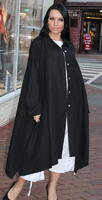 Long elegant black jacket with buttons across the front. This beautiful piece is ideal for formal events. It is best worn with a simple dress, or even a pair of jeans.