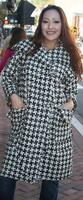 Classy long Houndstooth pattern coat with large front pockets.