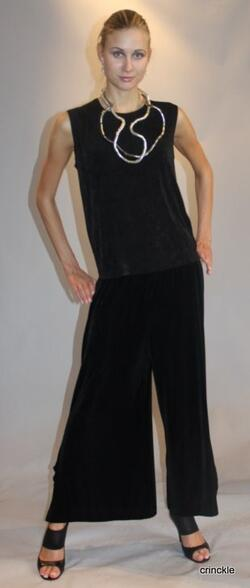 Elegant long black sleeveless slinky top and pants. Pair this outfit with an accessory and you're set!