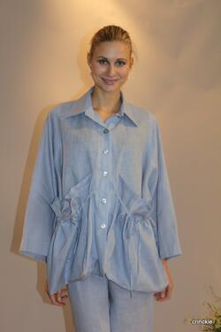 Beautiful light blue Linen jacket with large pockets in the front.