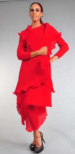 Stunning lustrous pleated red jacket. This piece is truly eye-catching and stunning. It's best when paired with a long pleated skirt or wide, loose pleated pants.