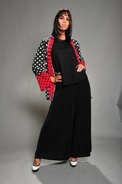 Black and white polka dot slinky jacket with red trim. Just like other slinky pieces, this jacket is very easy to care for when traveling.