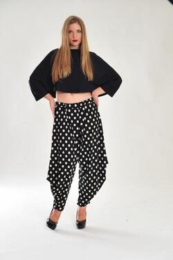 These beautiful jercy pants have a very playful, yet classy look. Wear them with a simple black top and you're ready to go! Available in Black, Brown, Gray, and Polka Dot (as pictured).