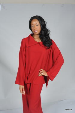 Modest red top with Plup neck collar and small pocket on the bottom right. Available in Red, Rust, and Black.