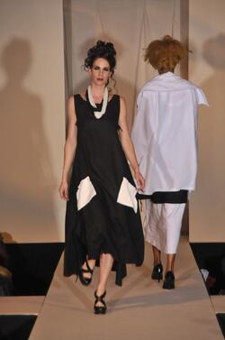 Beautiful long black linen dress worn at the DC fashion show. This unique piece is perfect for a gala or party.