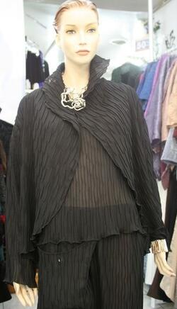 Elegant, thin box pleated jacket. This jacket is perfect when worn over a solid top and a matching pleated skirt.